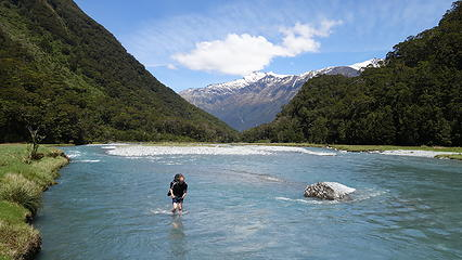Luca fording the Matukituki River at base of French Ridge