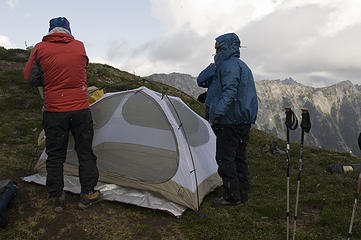 Matt and Dicey set up their tent while it snows