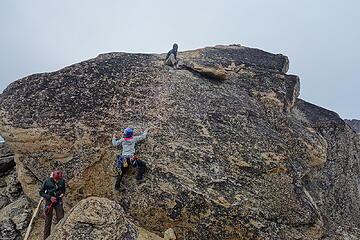 Jake Robinson Belaying summit of Snagtooth