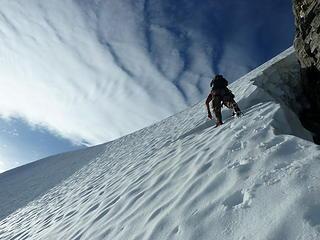 Sergio climbing steep snow below the summit.
