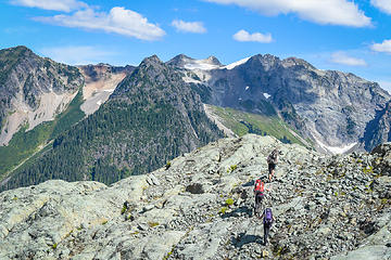 Traversing the slopes of Mt Watson with views of tomorrow's route up Bacon Peak
