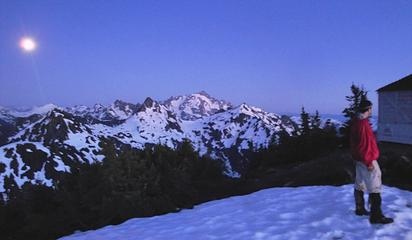 Gimpilator standing next to the Winchester Mountain lookout after sundown