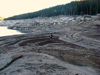 Mike hiking across the exposed lakebed
