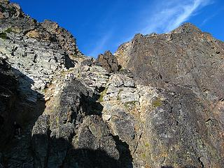Last gully upward to crest between east summit (right) and main summit (left).  (Note Yana in shadow)