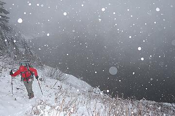 Carla hiking above snowy Lake Lillian