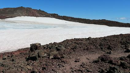 Hikers on the caldera snow, just below the true summit...