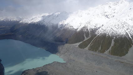Tasman Lake below at the terminus of the rock strewn Tasman Glacier