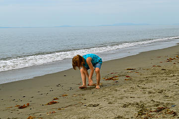 Abby pretending to dig for clams