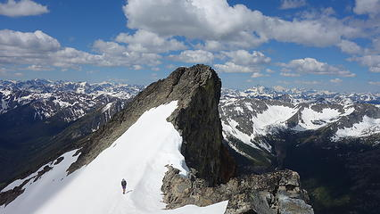 Josh traversing back from true summit of Monument