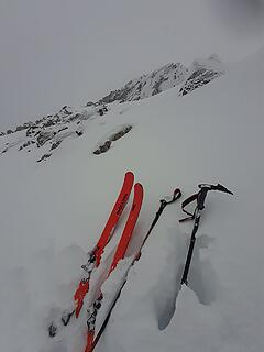 Ditching the skis, looking up at the summit