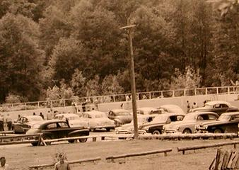 Cars in front of pool fence