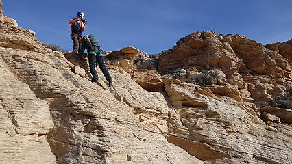 Downclimbing the final rotten slab