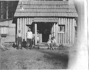 George Shaube homestead cabin Queets Valley - Alta (Northup) Shaube at left with son Lorne - 1923