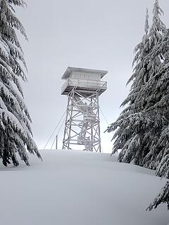 The lookout plastered with snow