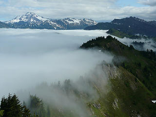 The cascade crest stops the clouds