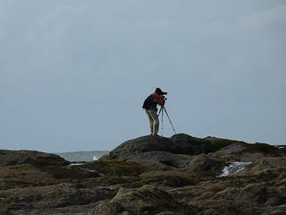 Lone photographer out on distant rocks