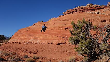 Scott sliding down the Page sandstone layer just below the summit