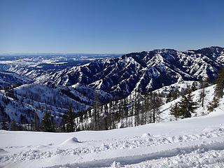 Looking south to Oregon. Several ranges are visible from here.  Saddle Butte is the last peak on the ridge right of center.