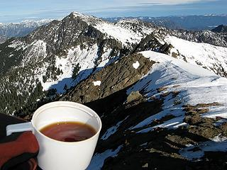 Summit Tea & Mt. Howard.  The wind is actually making waves in my cup.