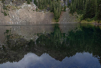 Smooth lake gives glassy reflection . . .