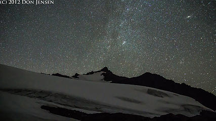 Sahale Peak above the Sahale Glacier.  Above that, on the upper right hand corner, is the Andromeda Galaxy.