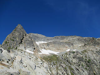 upper east face, go below the lower snow patch, then head straight up blocky rock and keep traversing right