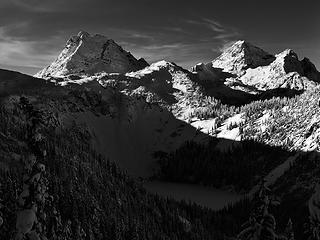 Corteo Peak and Black Peak rise above frozen Lake Ann in North Cascades National Park.