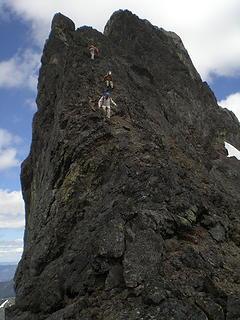 The gang down climbing the summit block.