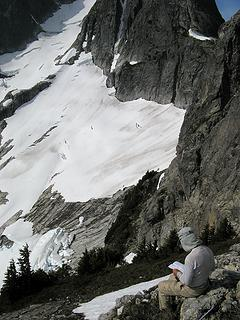 Studying Beckey on the way down (we need to get to the bare slabs below)