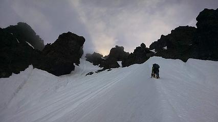 Climbing the large snow arete