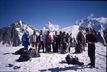 K2 from Gondogoro Pass with our Balti porter crew (lead guide third from the left) and one of the trekkers