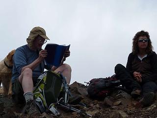 Jim K studying the summit register - Elle contemplating ????