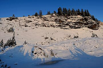 My shadow standing on a frozen tarn near camp.