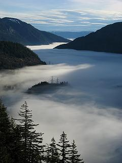 Morning light and shadows on the valley fog
