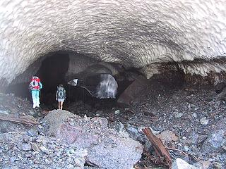 Trinity and Ice Girl entering snow cave at Big Four.