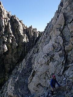 Scrambling to the north couloir down the sloping ledge