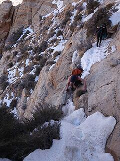 Navigating the icy narrow ledge