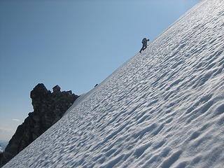 down climbing the steep snow