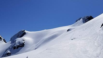 Final snowfield traverse to summit block