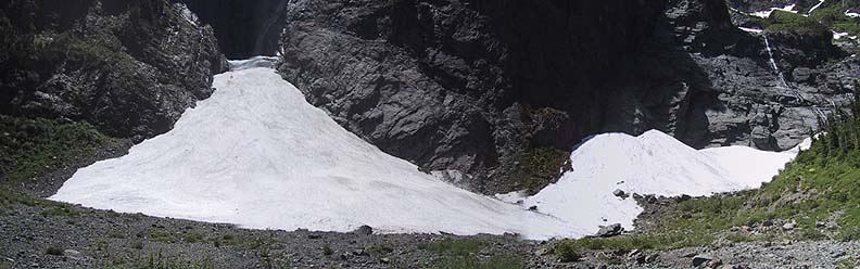 B4 Avalanche cone and snow piles. The snow cave that drains what will become the Ice Caves is visible just left of center.