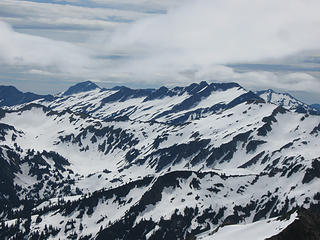 Looking SE from Black Mt.  Background:  left, Saul; right, Indian Head.  Foreground (blends with background): right, White Mt.; follow ridge to Pt 6770 at left, where trip ends (see panos taken from there).
