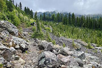 Rocky crossing and steep climb to the lake at the end.