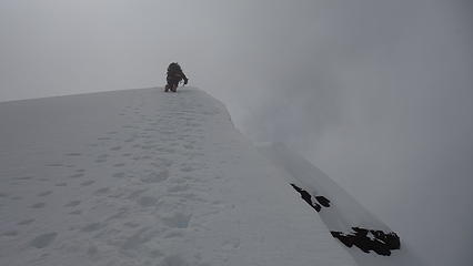 Downclimbing the ridge