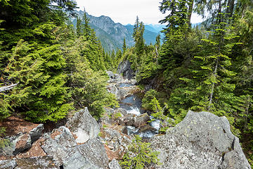 Angeline Creek emerges from the rock blocks just below our crossing point