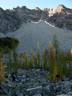 Crossing the bouldery basin below Hock