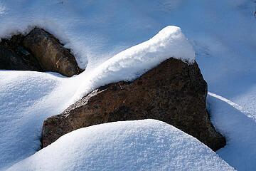 A picture of snow on a rock