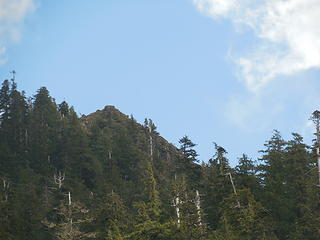 Zoom in on the summit of Chapel Peak from the lake