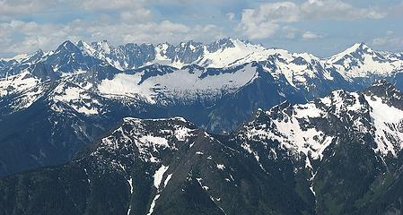 Northern Pickets, viewed from Hozomeen – our route comes up Little Beaver Creek deep in the foreground, crosses Challenger at the far right, and traverses behind all the northern peaks to Picket Pass at far left. (labeled)