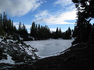 frozen over ridge lake