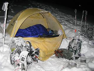 Snowy camp area. Carla tries to stay warm.